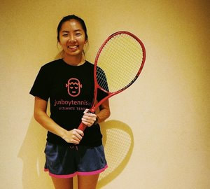 female tennis coach giving tennis lesson singapore